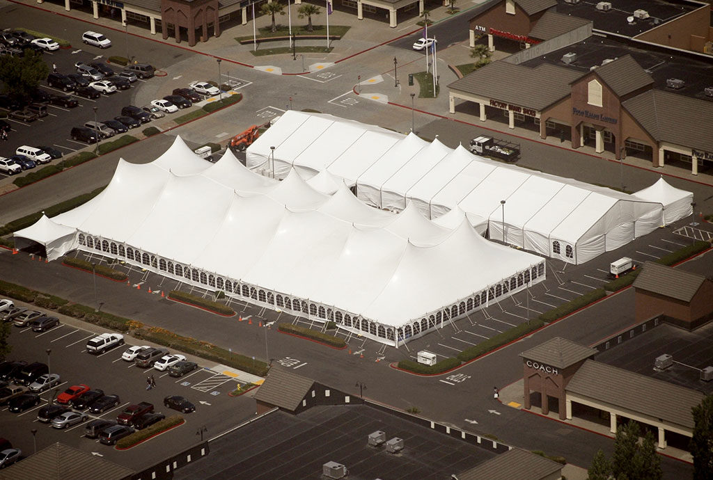 an arial photo of the Series 2000 Pole-tent and Fastrack Structure tent in a very large parking lot
