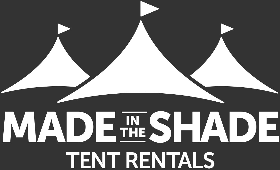 Made in the Shade logo in reverse white with dark background
