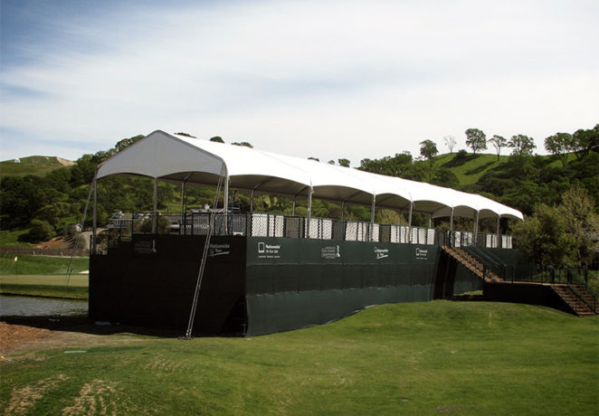An image of a large white Made in the Shade tent overlooking a golf course at & Golfing Events - Made in the ShadeMade in the Shade |