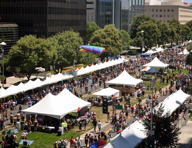An image of tents at a gay pride festival
