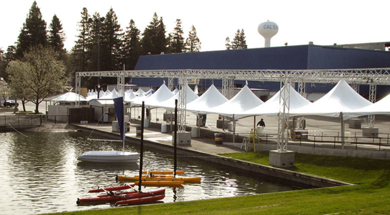 An image of small tents by a boat dock